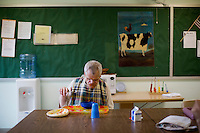 Caretakers help Fernald resident Ronnie Russo eat lunch at the Fernald Developmental Center in Waltham, Mass., USA.