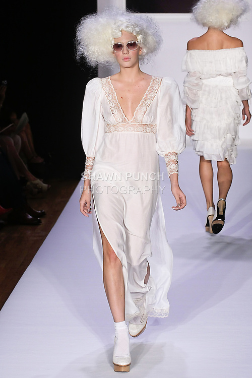 Manja walks runway in an ecru silk and cotton voile Abigail dress, Adele natural lace, and leather platform pump, for the bebe BLACK Spring 2012 collection fashon show, during Elle Stlye 360 Spring 2012 Fashion Week.