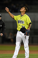 Closer Darwin Ramos (34) of the Columbia Fireflies points and looks skyward after recording the final out in a game against the Augusta GreenJackets on Friday, April 6, 2018, at Spirit Communications Park in Columbia, South Carolina. Columbia won, 7-2. (Tom Priddy/Four Seam Images)