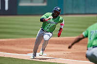Abraham Almonte (7) of the Gwinnett Stripers rounds third base during the game against the Charlotte Knights at Truist Field on May 9, 2021 in Charlotte, North Carolina. (Brian Westerholt/Four Seam Images)
