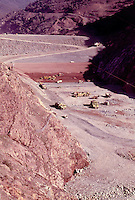 Removing rock and leveling dirt for construction of a dam. California, Melones Dam.