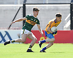 Joey Droney of Clare in action against David Mangan of Kerry during their Munster Minor football final at Pairc Ui Chaoimh. Photograph by John Kelly.