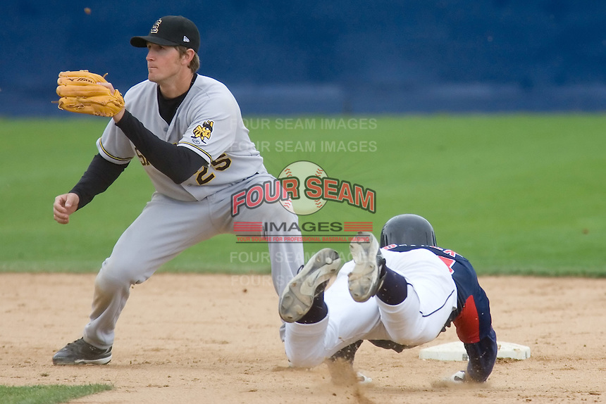 June 1, 2008: Salt Lake Bees' Adam Pavkovich awaits the throw to second base from catcher Flint Wipke as Tacoma Rainiers pinch runner Josh Womack slides head first into the bag.  The Bees defeated the Rainiers, 6-4, at Cheney Stadium in Tacoma, Washington.