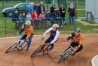 19 APR 2015 - IPSWICH, GBR - Josh Brooke (centre) of Ipswich Eagles races Damian Zareba (left) and Mikey Hewitson (right) of Sheffield Stars into the first corner during the two teams Elite League cycle speedway fixture at Whitton Sports and Community Centre in Ipswich, Suffolk, Great Britain (PHOTO COPYRIGHT © 2015 NIGEL FARROW, ALL RIGHTS RESERVED)