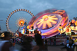 Carnival rides light up the evening sky during Oktoberfest in Munich, Germany. Oct. 2, 2007.