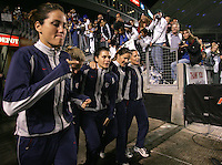 From left to right, Julie Foudy, Kristine Lilly, Mia Hamm, Brandi Chastain, and Joy Fawcett walk onto the field for Hamm, Foudy, and Fawcett's last soccer match, at the Home Depot Center in Carson, Calif., Tuesday, Dec., 7, 2004.