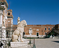 A side view of the Porta Magna of the Venetian Arsenal. In the foreground is the Piraeus Lion, taken as booty by Francesco Morosini from the Greek port of Piraeus.