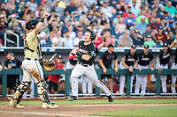 Louisville Cardinals catcher Henry Davis (32) sprints towards the plate during Game 12 of the NCAA College World Series against the Vanderbilt Commodores on June 21, 2019 at TD Ameritrade Park in Omaha, Nebraska. Vanderbilt defeated Louisville 3-2. (Andrew Woolley/Four Seam Images)