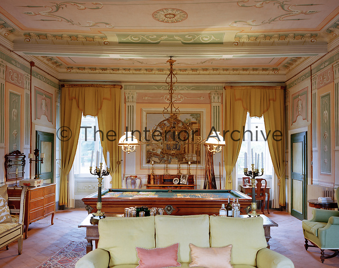 With windows facing both north and south, the neoclassical-styled living room on the first floor features early 19th-century trompe l'oeil murals
