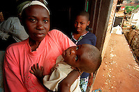 Kigali / Rwanda.Poor and abandoned mothers and their disabled children supported by humanitarian association Jya Mubandi Mwana.<br />