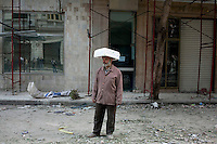 A man with an improvised helmet on a road leading to Tahrir Square. Throughout Friday, 4 February, anti government protesters protected their positions from pro Mubarak supporters around Tahrir square, the scene of heavy clashes between pro and anti government protesters. Continued anti-government protests take place in Cairo calling for President Mubarak to stand down. After dissolving the government and allowing for talks with opposition parties Mubarak still refuses to step down from power...