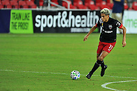 WASHINGTON, DC - SEPTEMBER 27: Yamil Asad #11 of D.C. United moves the ball during a game between New England Revolution and D.C. United at Audi Field on September 27, 2020 in Washington, DC.