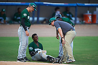 Daytona Tortugas trainer Kyle Utne looks at Shed Long (13) after getting hit as manger Eli Marrero (left) and coach Gookie Dawkins (right) look on during a game against the Brevard County Manatees on August 14, 2016 at Space Coast Stadium in Viera, Florida.  Daytona defeated Brevard County 9-3.  (Mike Janes/Four Seam Images)