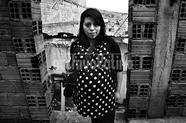 Claudia Pamela Morales Laruta.They are all between their  20's and 30's. They like to call themselves Kamikazes, and they are the new generation of street photo journalists of Bolivia. In a country where photographers are extremely poorly paid, no one can image that this army of young guys and girls are always ready to risk their lives running behind they care most: a good picture telling a news.<br /> Thought the new eyes of this young generation, our photographer and friend in La Paz, French born Cristian Lombardi shows the impacting reality of this South American mostly indigenous nation. In a patient work, Lombardi edited thousands of frames to show as a glimpse of what these new young eyes are watching.