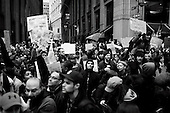 """New York, New York<br /> November 17, 2011<br /> <br /> """"Occupy Wall Street"""" protesters mark the movement's two-month milestone by marching from Zuccotti Park, in mass, to various access streets surrounding the New York Stock Exchange, which the police had barricaded off. Yet instead of the police keeping protesters out, protesters locked down those entrances to Wall Street and the New York Stock Exchange creating havoc as the police made more then 240 arrests to try and keep the streets open to normal traffic.<br /> <br /> Thousands of protesters are meet with barricades, police on houses and baton wielding riot police at Nassau just one block form the NYSE."""