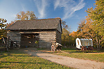 Lincoln Log Cabin State Historic Site, Coles County, IL<br /> Historic 1840 farm scene with a split log barn and covered wagon, a living history farm