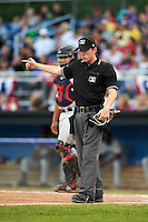 Umpire Tyler Jones signals fair ball during a game between the Mahoning Valley Scrappers and Batavia Muckdogs on July 3, 2015 at Dwyer Stadium in Batavia, New York.  Batavia defeated Mahoning Valley 7-4.  (Mike Janes/Four Seam Images)