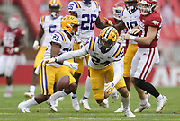 LSU cornerback Derek Stingley Jr. (24) reaches to recover a fumble, Saturday, November 21, 2020 during the third quarter of a football game at Donald W. Reynolds Razorback Stadium in Fayetteville. Check out nwaonline.com/201122Daily/ for today's photo gallery. <br /> (NWA Democrat-Gazette/Charlie Kaijo)