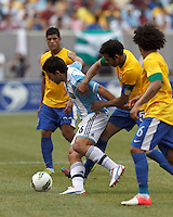 Argentina substitute forward  Sergio Aguero (16) dribbles as Brazil midfielder Sandro (5) pressures. In an international friendly (Clash of Titans), Argentina defeated Brazil, 4-3, at MetLife Stadium on June 9, 2012.