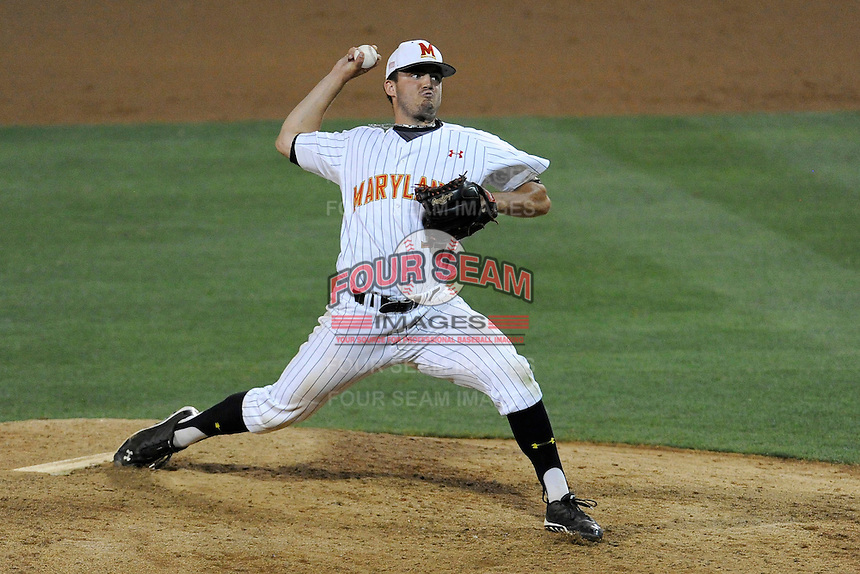 Relief pitcher Kevin Mooney (33) of the Maryland Terrapins throws a pitch in an NCAA Division I Baseball Regional Tournament game against the South Carolina Gamecocks on Saturday, May 31, 2014, at Carolina Stadium in Columbia, South Carolina. Maryland won, 4-3. (Tom Priddy/Four Seam Images)