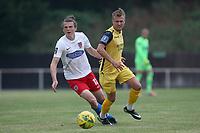 Matt Robinson of Dagenham and Liam Nash of Hornchurch during Hornchurch vs Dagenham & Redbridge, Friendly Match Football at Hornchurch Stadium on 24th July 2021