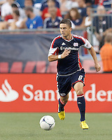 New England Revolution defender Chris Tierney (8) brings the ball forward. In a Major League Soccer (MLS) match, Sporting Kansas City defeated the New England Revolution, 1-0, at Gillette Stadium on August 4, 2012.