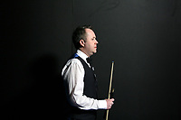 CHINA. Beijing. Scottish snooker player John Higgins backstage just before going to play at the China Snooker Open. Snooker is a cue sport played on a large table measuring 3.6 metres x 1.8 metres. Originating in India in the late 19th Century where it was invented by British Army officers, the game has been a mainstay in British sport over the past few decades. Recently however, popularity of the sport has declined as the sport struggles to compete with other popular sports. The sport is however flourishing in countries such as China, where it is now the second most popular sport, behind Basketball. In a country where the  players are treated like movie-stars, China may be the great hope for the sports recovery. 2009