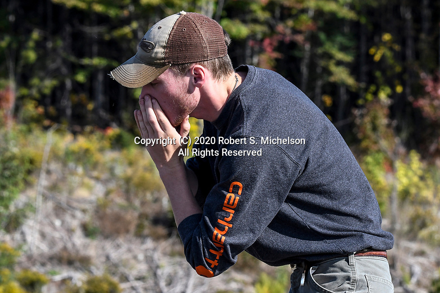 Maine Department of Inland Fisheries and Wildlife Wildlife Technician, Carter Barthelman, calls for moose. During the moose breeding season-the rut.   Moose hunters try to imitate the call of a cow in estrus.  This call is a long, plaintive moaning.   This is telling a bull that she is receptive and ready to breed. <br /> If a bull responds to the cow, the bull will make a deep, guttural grunt expelling air.   He will make the call repeatingly as he moves towards the cow call and tries to scent the female.