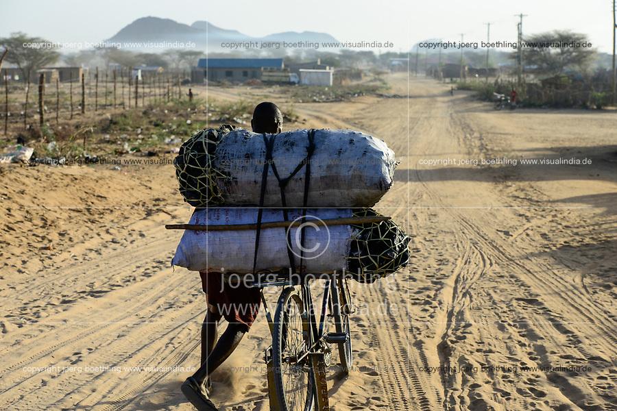 KENYA Turkana, Lodwar, transport of charcoal with bicycle / KENIA Turkana, Lodwar, Transport von Holzkohle mit Fahrrad