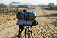 KENYA Turkana, Lodwar, transport of charcoal with bicycle / KENIA Turkana, Lodwar, Transport von Holzkohle mit Fahrrad