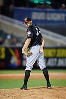 Chattanooga Lookouts relief pitcher Luke Bard (24) glances over his shoulder at the runner on first base during a game against the Jackson Generals on April 27, 2017 at The Ballpark at Jackson in Jackson, Tennessee.  Chattanooga defeated Jackson 5-4.  (Mike Janes/Four Seam Images)