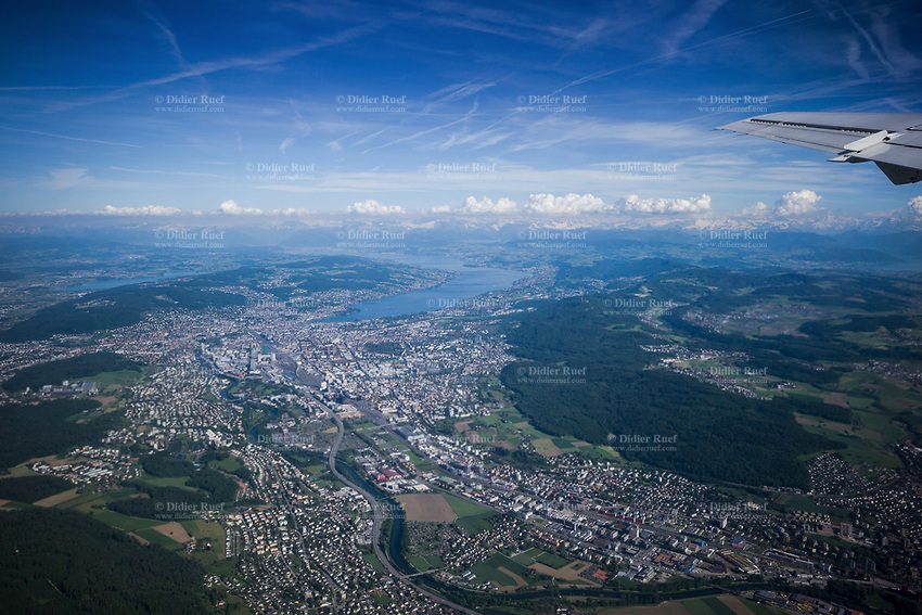 Switzerland. Canton Zürich. Aerial view from the city of Zürich, its surroundings and the lake. View from a Saab 2000 airplane after take off from Zurich Airport. The Adria Airways company works on behalf of Swiss for a connecting flight from Zürich to Lugano. Swiss International Air Lines AG (stylised as SWISS), commonly referred to as Swiss, is the national airline of Switzerland. The Saab 2000 is a twin-engined high-speed turboprop airliner built by Saab. It is designed to carry 50–58 passengers and cruise at a speed of 665 km/h. 1.06.2019 © 2019 Didier Ruef