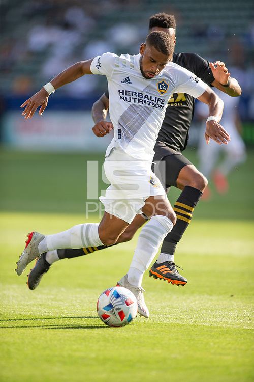 CARSON, CA - MAY 8: Samuel Grandsir #11 of the Los Angeles Galaxy moves with the ball during a game between Los Angeles FC and Los Angeles Galaxy at Dignity Health Sports Park on May 8, 2021 in Carson, California.