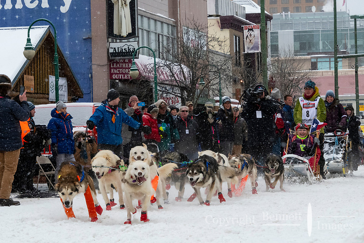 Lindwood Fiedler and team leave the ceremonial start line with an Iditarider and handler at 4th Avenue and D street in downtown Anchorage, Alaska on Saturday March 7th during the 2020 Iditarod race. Photo copyright by Cathy Hart Photography.com