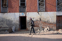 A man walks in the street of Bhaktapur, near Kathmandu, Nepal.  May 03, 2015.