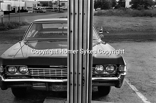 Drive In 1960s fast food resturant, small table fixed to door of car when order comes.  New Brunswick, New Jersey. 1969,
