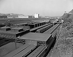 Pittsburgh PA: View of the Pennsylvania Railroad yard in Pittsburgh with the Strip District in the background.