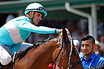 LOUISVILLE, KY - MAY 06: Jockey Florent Geroux splashes water on Roca Rojo #6 after winning the Churchill Distaff Turf Mile Stakes on Kentucky Derby Day at Churchill Downs on May 6, 2017 in Louisville, Kentucky. (Photo by Mary Meek/Eclipse Sportswire/Getty Images)