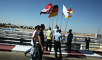The flags of the national playing to the day's games are posted on the road leading to the entry to the Mubarak Stadium before the FIFA Under 20 World Cup Group C Match between the United States and Germany at the  on September 26, 2009 in Suez, Egypt. The US lost to Germany 3-0.