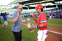 Former Chicago Cubs catcher David Ross shakes hands with Kameron Ojeda (27) of St. John Bosco High School in La Mirada, California after throwing out the first pitch before the Under Armour All-American Game presented by Baseball Factory on July 29, 2017 at Wrigley Field in Chicago, Illinois.  (Mike Janes/Four Seam Images)