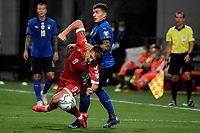 Edgaras Utkus of Lithuania and Giovanni Di Lorenzo of Italy compete for the ball during the Qatar 2022 world cup qualifying football match between Italy and Lithuania at Citta del tricolore stadium in Reggio Emilia (Italy), September 8th, 2021. Photo Andrea Staccioli / Insidefoto