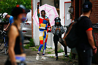 A protest put on by LGBTQ+ Coalition and Trans YOUniting stand outside the offices of the Delta Foundation on the North Side on Tuesday July 7, 2020 in Pittsburgh, Pennsylvania. (Photo by Jared Wickerham/Pittsburgh City Paper)