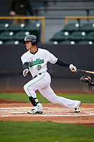 Clinton LumberKings second baseman Bryson Brigman (8) follows through on a swing during a game against the Lansing Lugnuts on May 9, 2017 at Ashford University Field in Clinton, Iowa.  Lansing defeated Clinton 11-6.  (Mike Janes/Four Seam Images)