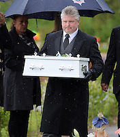 Pictured: An undertaker carries the coffin of baby Sion at the burial site at Thornhill Cemetery, Cardiff, Wales, UK. Tuesday 28 June 2016<br /> Re: The funeral of Sion, the baby boy found dead in the River Taff in Cardiff has taken place<br /> Generous locals raised nearly £1,400 for the memorial after reading about plans to hold a fitting ceremony for the newborn baby whose body was discovered in Cardiff a year ago.<br /> The funeral took place at the Briwnant Chapel at Thornhill Crematorium, Cardiff. Members of the public are invited to be among the congregation.