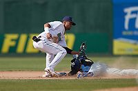 Lynchburg Hillcats shortstop Yordys Valdes (7) fields a throw as Edmond Americaan (20) of the Myrtle Beach Pelicans slides head-first into second base during the game against the Myrtle Beach Pelicans at Bank of the James Stadium on May 23, 2021 in Lynchburg, Virginia. (Brian Westerholt/Four Seam Images)