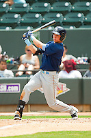 Drew Robinson (33) of the Myrtle Beach Pelicans follows through on his swing against the Winston-Salem Dash at BB&T Ballpark on July 7, 2013 in Winston-Salem, North Carolina.  The Pelicans defeated the Dash 4-2 in game one of a double-header.  (Brian Westerholt/Four Seam Images)