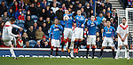 Rangers players form a staunch wall to defend a free-kick