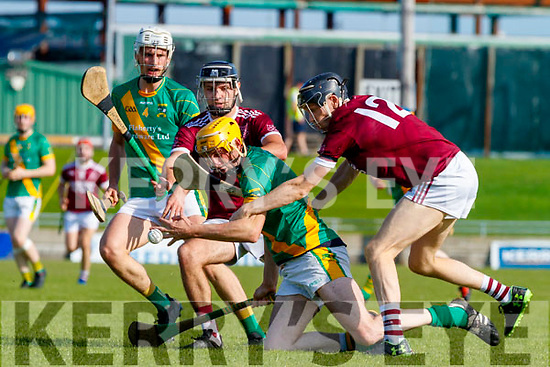 Tom Murnane, Kilmoyley in action against Gavin Dooley and Colm Harty, Causeway during the Kerry County Senior Hurling Championship Final match between Kilmoyley and Causeway at Austin Stack Park in Tralee