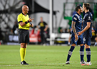 LAKE BUENA VISTA, FL - AUGUST 01: Referee Robert Sibiga speaks to James Sands#16 of New York City FC during a game between Portland Timbers and New York City FC at ESPN Wide World of Sports on August 01, 2020 in Lake Buena Vista, Florida.