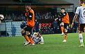 Dundee Utd's Charlie Telfer scores their first goal.